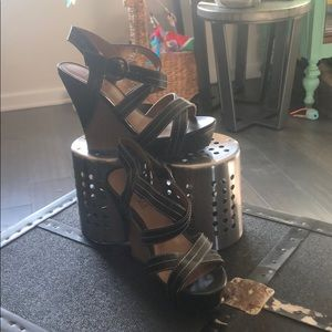Wedges with black crisscross straps